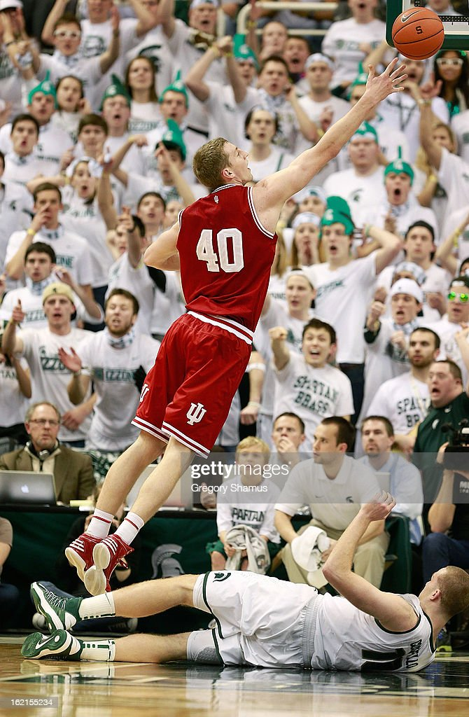 <a gi-track='captionPersonalityLinkClicked' href=/galleries/search?phrase=Cody+Zeller&family=editorial&specificpeople=7621233 ng-click='$event.stopPropagation()'>Cody Zeller</a> #40 of the Indiana Hoosiers shoots a second half shot after Matt Costello #10 of the Michigan State Spartans fell down at the Jack T. Breslin Student Events Center on February 19, 2013 in East Lansing, Michigan. Indiana won the game 72-68.