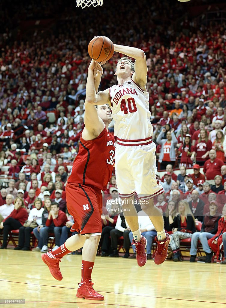 <a gi-track='captionPersonalityLinkClicked' href=/galleries/search?phrase=Cody+Zeller&family=editorial&specificpeople=7621233 ng-click='$event.stopPropagation()'>Cody Zeller</a> #40 of the Indiana Hoosiers shoots the ball and is fouled by Andre Almeida #32 of the Nebraska Cornhuskers during the game at Assembly Hall on February 13, 2013 in Bloomington, Indiana.