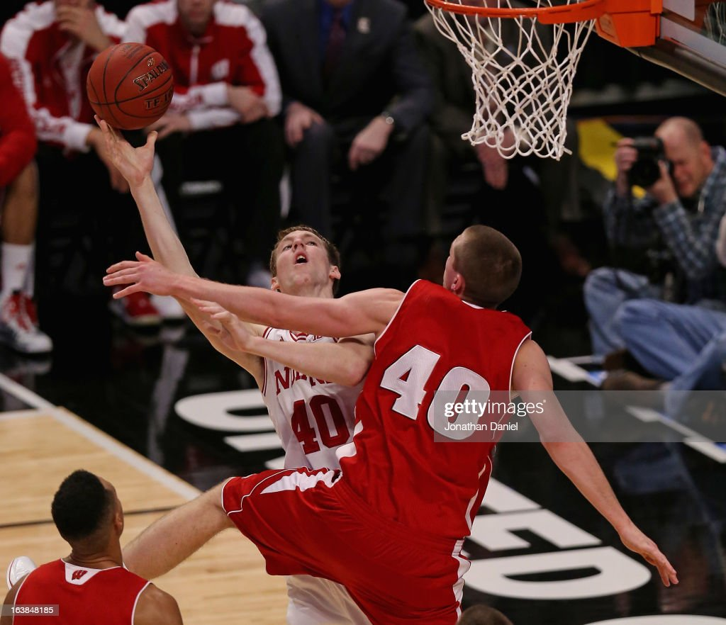 Cody Zeller #40 of the Indiana Hoosiers tries to shoot against Jared Berggren #40 of the Wisconsin Badgers during a semifinal game of the Big Ten Basketball Tournament at the United Center on March 16, 2013 in Chicago, Illinois.