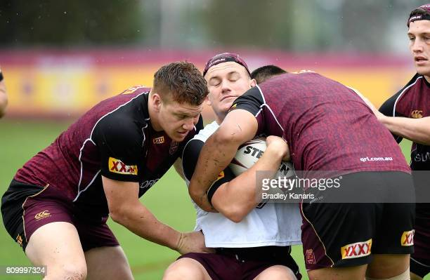 Coen Hess is tackled during a Queensland Maroons State of Origin training session at Sanctuary Cove on July 7 2017 in Brisbane Australia