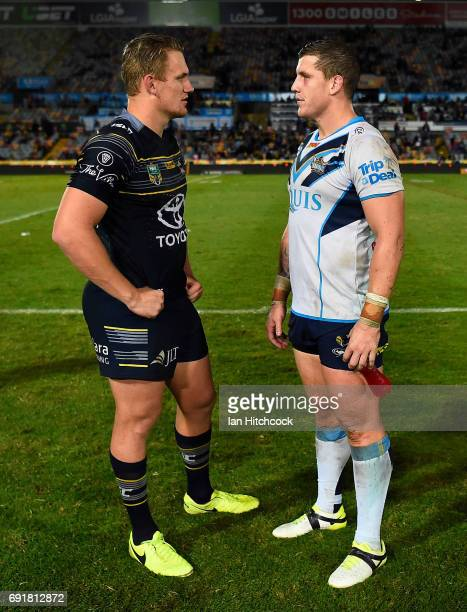 Coen Hess of the Cowboys and Jarrod Wallace of the Titans talk with each other at the end of the round 13 NRL match between the North Queensland...