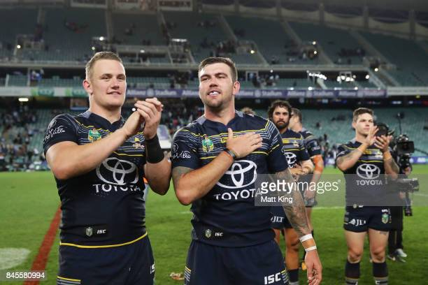 Coen Hess of the Cowboys and Kyle Feldt of the Cowboys celebrate victory at the end of during the NRL Elimination Final match between the Cronulla...