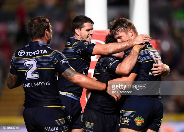 Coen Hess of the Cowboys celebrates after scoring a try during the round 13 NRL match between the North Queensland Cowboys and the Gold Coast Titans...