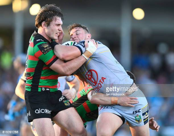Coen Hess of the Cowboys is tackled by Angus Crichton of the Rabbitohs during the round 19 NRL match between the South Sydney Rabbitohs and the North...