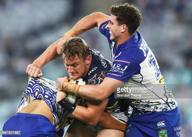 Coen Hess of the Cowboys is tackled by the Bulldogs defence during the round 10 NRL match between the Canterbury Bulldogs and the North Queensland...