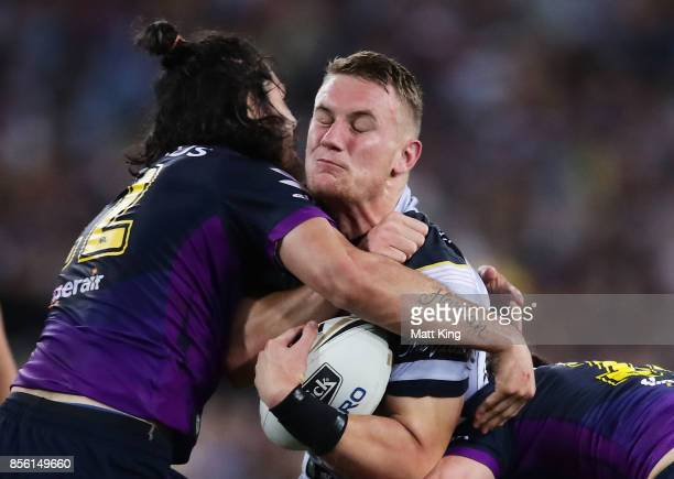 Coen Hess of the Cowboys is tackled by Tohu Harris of the Storm during the 2017 NRL Grand Final match between the Melbourne Storm and the North...