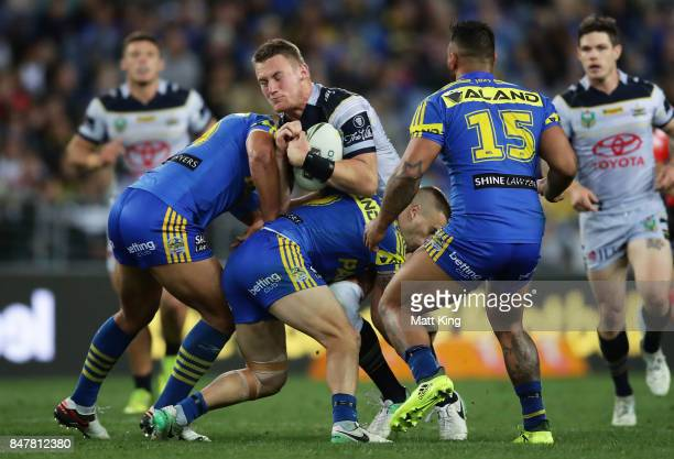 Coen Hess of the Cowboys is tackled during the NRL Semi Final match between the Parramatta Eels and the North Queensland Cowboys at ANZ Stadium on...