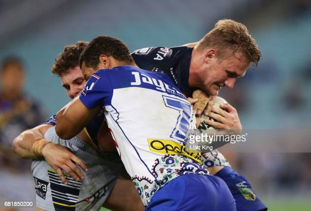 Coen Hess of the Cowboys is tackled during the round 10 NRL match between the Canterbury Bulldogs and the North Queensland Cowboys at ANZ Stadium on...