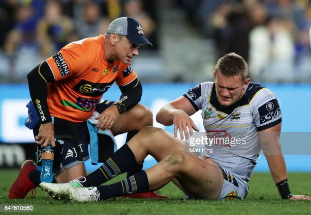 Coen Hess of the Cowboys recieves treatment after going down injured during the NRL Semi Final match between the Parramatta Eels and the North...