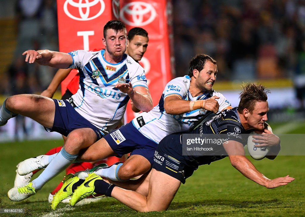Coen Hess of the Cowboys scores a try during the round 13 NRL match between the North Queensland Cowboys and the Gold Coast Titans at 1300SMILES Stadium on June 3, 2017 in Townsville, Australia.