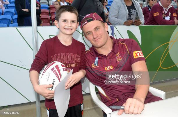 Coen Hess poses for a photo with a young fan during a Queensland Maroons State of Origin fan day on June 14 2017 in Mackay Australia