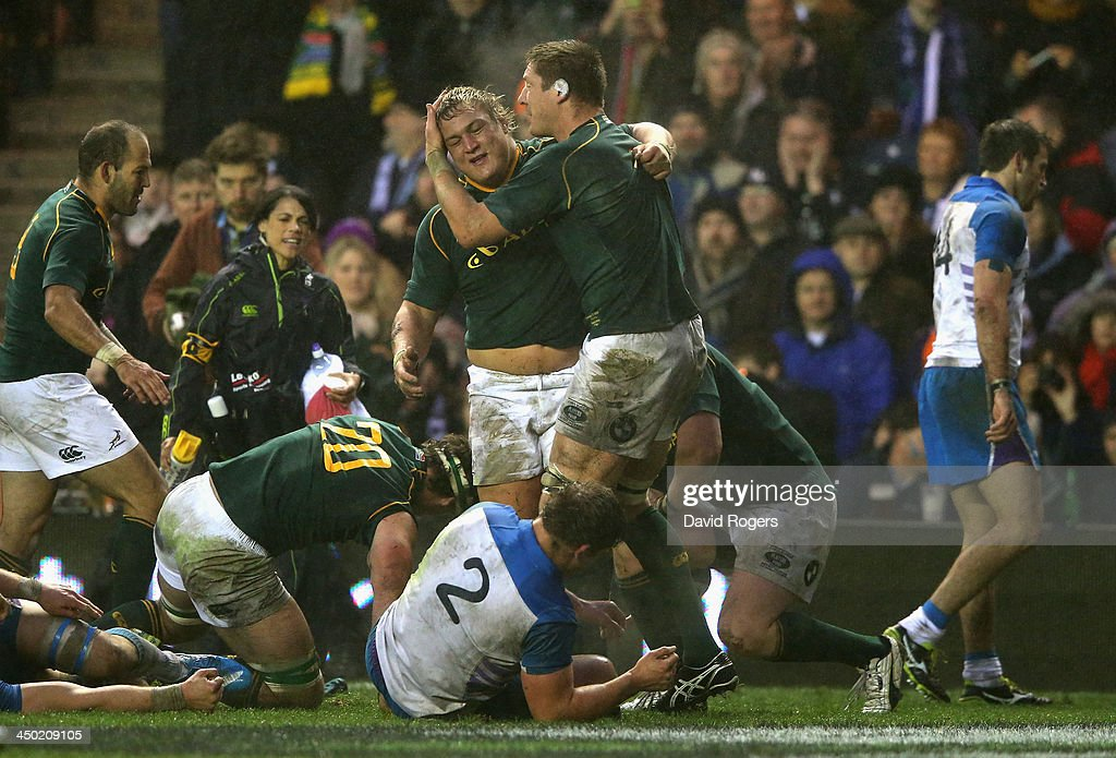 Coenie Oosthuizen of South Africa is congratulated by Bakkies Botha (R) after scoring a try during the International match between Scotland and South Africa at Murrayfield Stadium on November 17, 2013 in Edinburgh, Scotland.