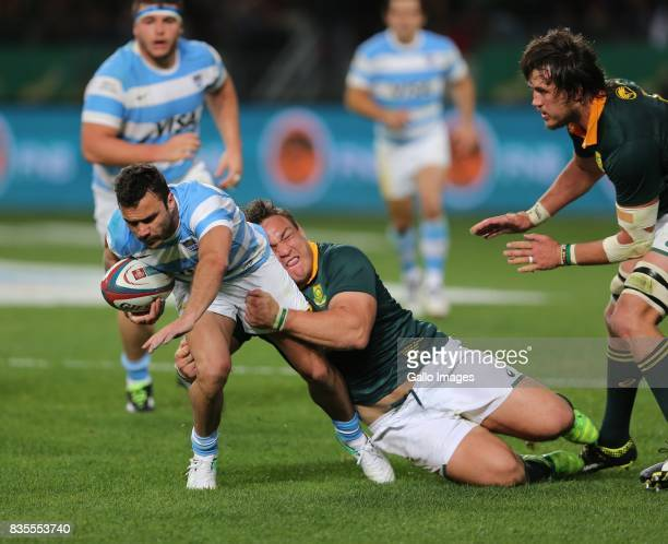 Coenie Oosthuizen of South Africa tackles Martin Landajo of Argentina during the Rugby Championship match between South Africa and Argentina at...
