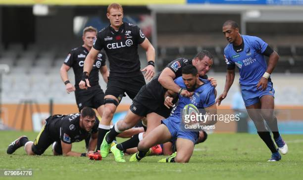 Coenie Oosthuizen of the Cell C Sharks tackling Curtis Rona of Western Force during the Super Rugby match between Cell C Sharks and Force at...