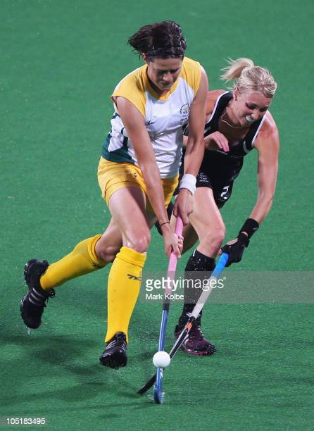 Coetzee Pietie of South Africa and Emily Naylor of New Zealand compete for the ball during the Women's Semifinal match between New Zealand and South...