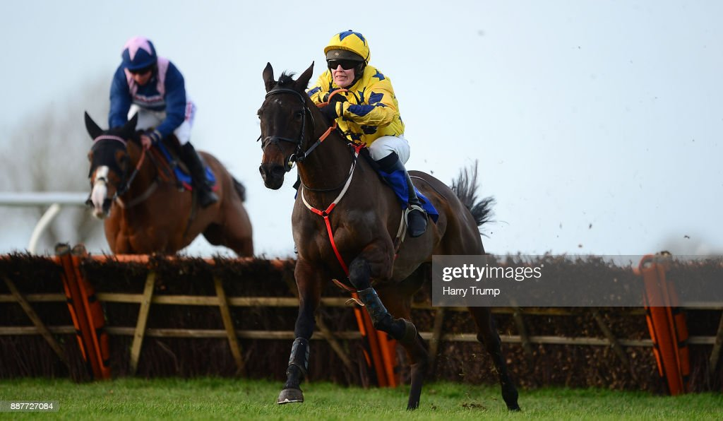 Coeur Blimey ridden by Lucy Gardner(R) on their way to winning the Weatherbys Racing Bank Handicap Hurdle at Wincanton Racecourse on December 7, 2017 in Wincanton, England.
