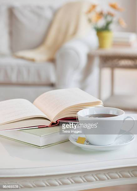 Coffee and book on table