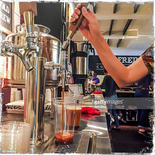West Hollywood Ca February 6 2015 A coffee barista draws a cup of nitro coffee from the tap at Alfred's in west Hollywood