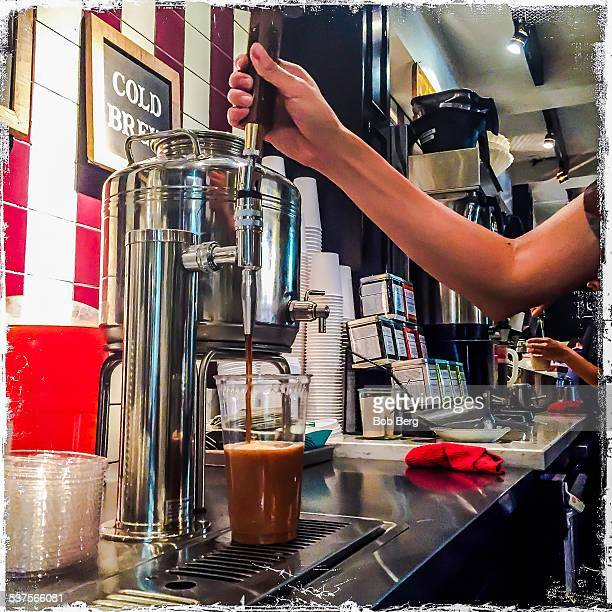 West Hollywood Ca February 6 2015 A coffee barista pours a nitro coffee from the tap at Alfred's in west hollywood