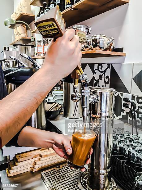 Santa Monica Ca February 5 2015 A coffee barista pours a nitro coffee into a glass from a tapped keg of Stumptown cold brewed coffee at Lo/Cal coffee...