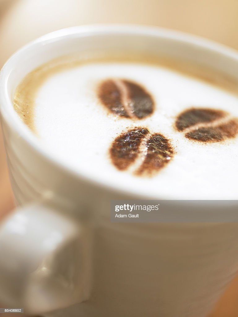 Coffee bean decoration on foam in coffee cup : Stock Photo