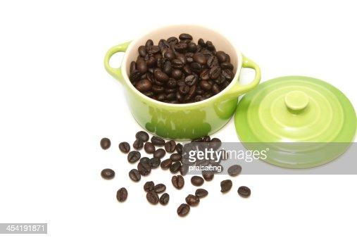 Chicco di caffè in tazza verde : Foto stock