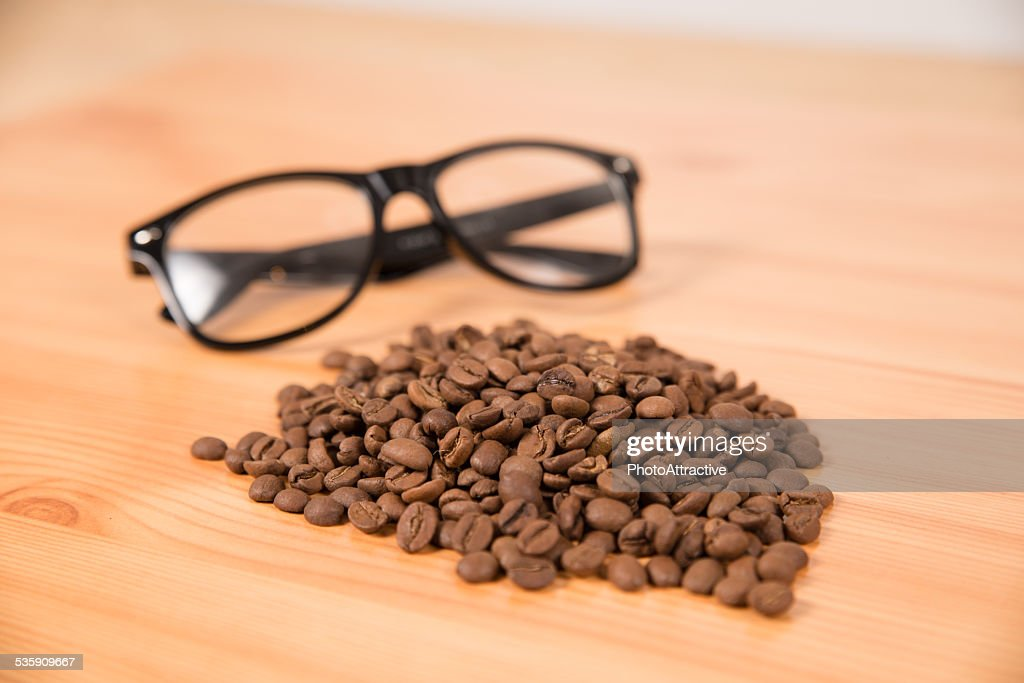 Coffee beans and glasses : Stock Photo
