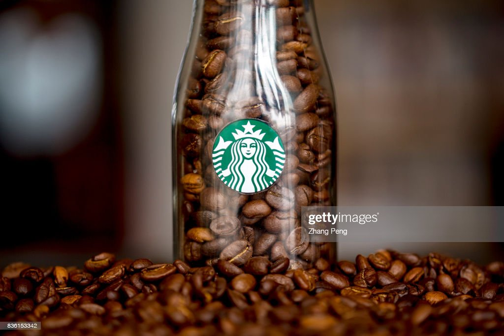 Coffee beans and Starbucks logo, arranged for photography. In the second quarter of 2017, the Starbuck's sales grew by 4% compared with the same period in 2016, higher than other competitors.