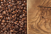 Coffee beans and wooden ground