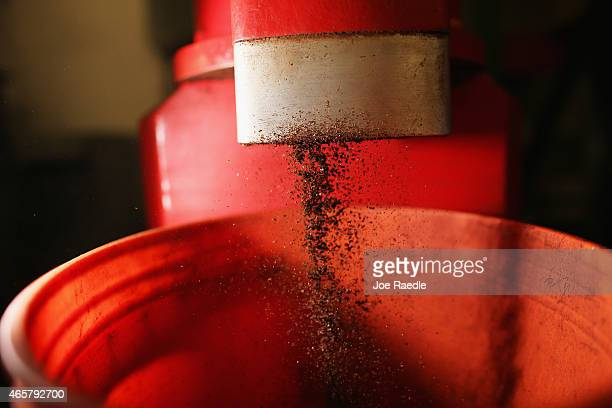Coffee beans are ground in a grinder during the process of making the Miami Beach blend of coffee at the Kana Coffee Roasters on March 10 2015 in...
