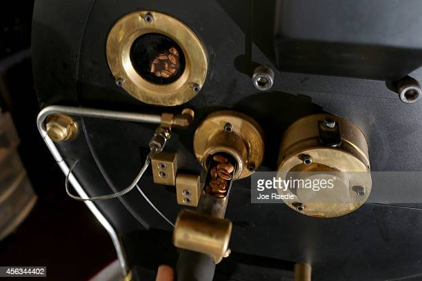 Coffee beans are seen in the roaster at Eternity Coffee Roasters during National Coffee Day on September 29 2014 in Miami Florida The day is for...