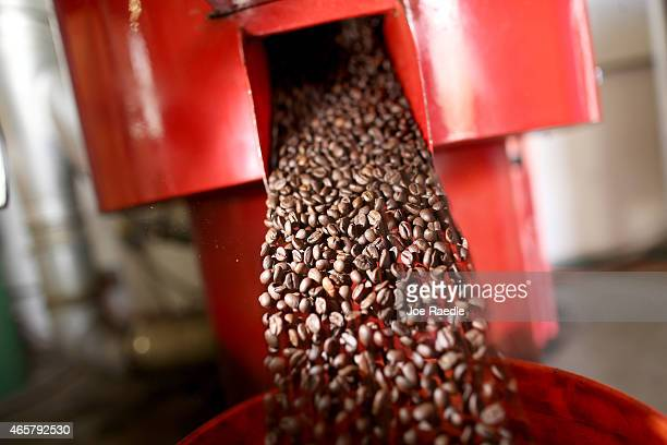 Coffee beans are seen in the roaster during the process of making the Miami Beach blend of coffee at the Kana Coffee Roasters on March 10 2015 in...
