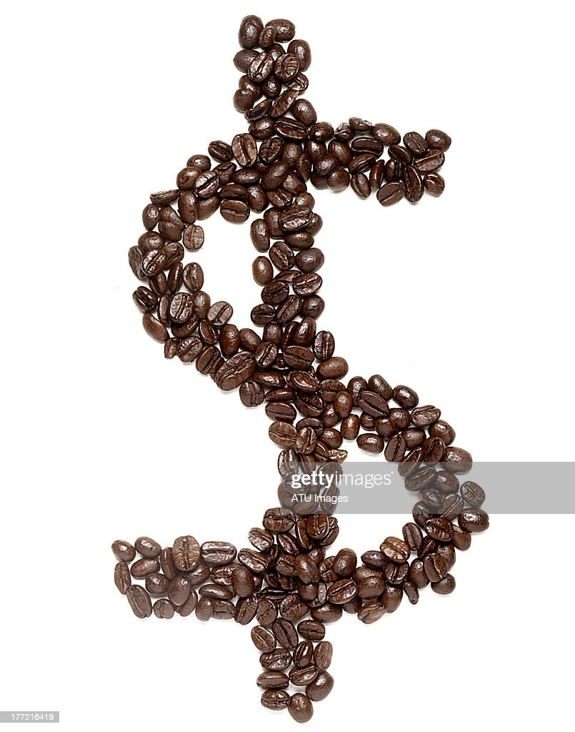 Coffee beans as a dollar sign : Stock Photo