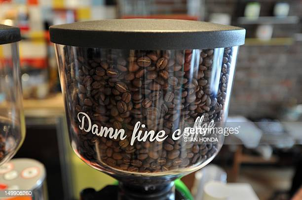 Coffee beans in a grinder at the Everyman Expresso coffee house July 31 2012 in the Soho section of New York AFP PHOTO/Stan HONDA