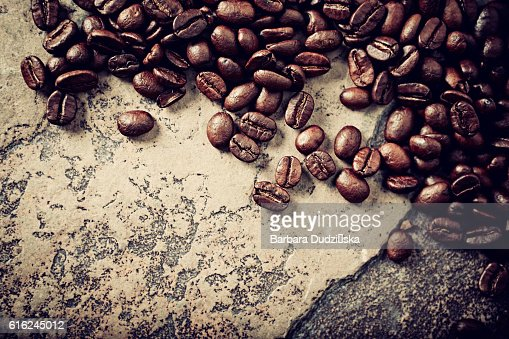 Coffee beans on a rustic stone background : Stock Photo