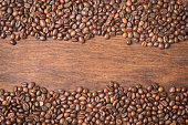 Coffee beans on a wooden table.