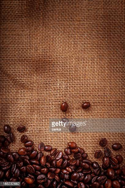 Coffee beans on burlpab background