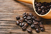 Top view of Coffee beans on old wooden table