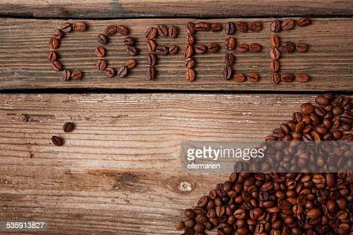 coffee beans on wooden background : Stock Photo