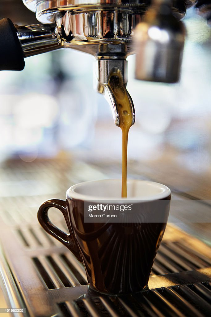 Coffee Being Poured into Mug