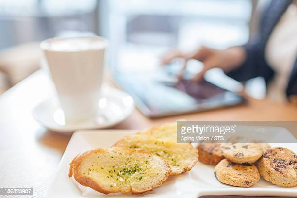 Coffee, bread, cookies and a businesswoman