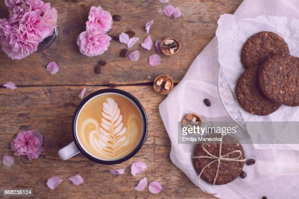 Coffee break concept. Coffee and dark chip cookies on wooden table