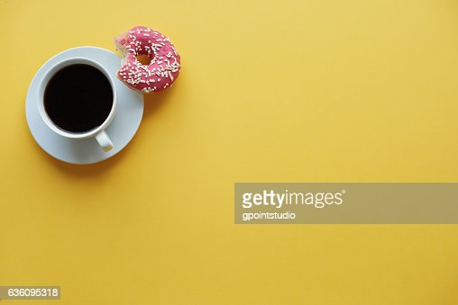 Coffee break time with donuts : Stock Photo