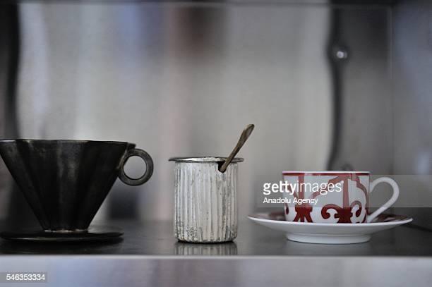 A coffee can a coffee filter a sugar bowl and a coffee cup are seen in the kitchen of minimalist Saeko Kubishiki in Fujisawa Kanagawa Prefecture in...