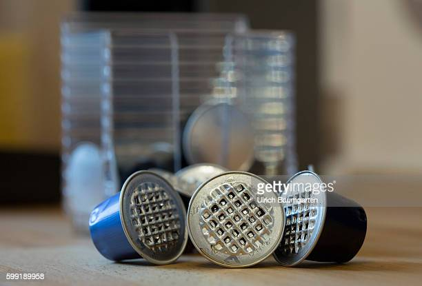 Coffee capsules for the quick and convenient coffee but with problems for the environment The picture shows used coffee capsules of metal in front of...