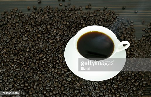 Coffee cup and beans : Stock Photo