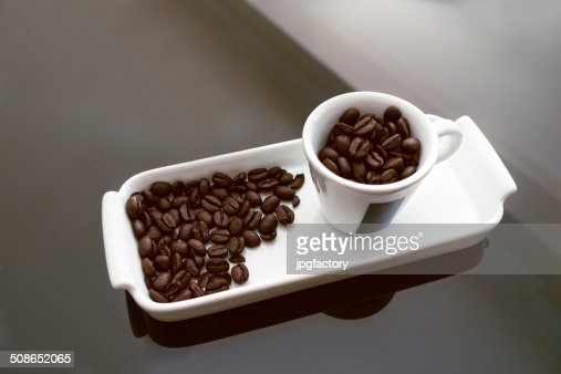 coffee cup and coffee beans : Stock Photo