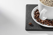 Coffee cup and coffee beans with copy space