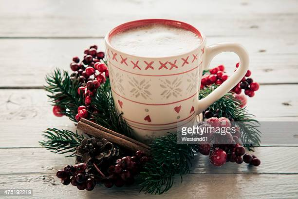 Coffee cup in between christmas decoration