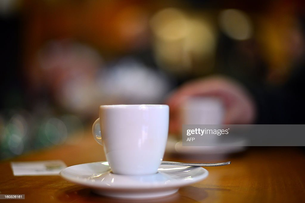 A coffee cup is displayed on the counter of a bar on January 29, 2013 in Rome. AFP PHOTO / GABRIEL BOUYS